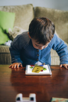 Little boy playing with tablet at home - JPSF00027