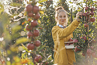 Young woman harvesting apples - KNSF00715