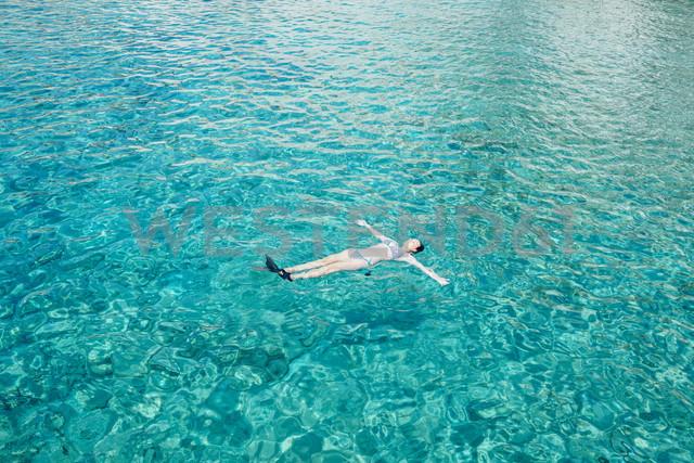 Greece, Milos, Woman floating on water - GEMF01320