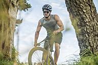 Young man mountain biking in nature - ZEF11877