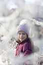Portrait of happy girl wearing bobble hat in winter - SARF03097