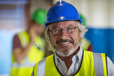 Senior engineer wearing safety helmet, portrait - ZEF11929