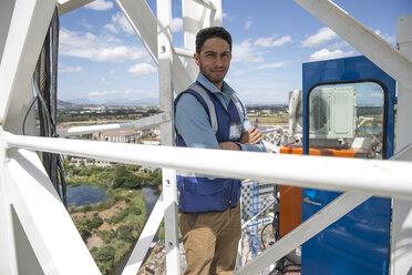 Engineer standing on construction crane - ZEF11974