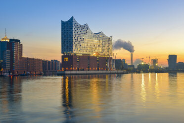 Germany, Hamburg, lighted Elbe Philharmonic Hall at morning twilight - RJF00650