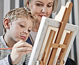 Grandmother and grandson with Dali moustache at easel - RHF01687