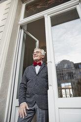 Smiling senior man at the window - RHF01753