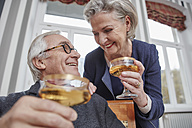 Happy senior couple drinking champagne - RHF01756