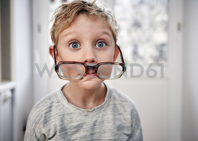Portrait of playful boy with oversized glasses - RHF01768