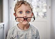 Portrait of playful boy with oversized glasses - RHF01768