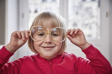 Portrait of girl wearing oversized glasses - RHF01771