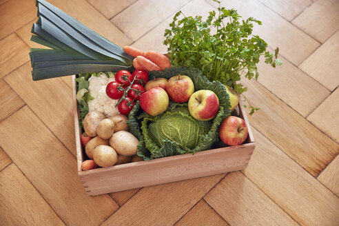 Box with produce on parquet floor - RHF01792