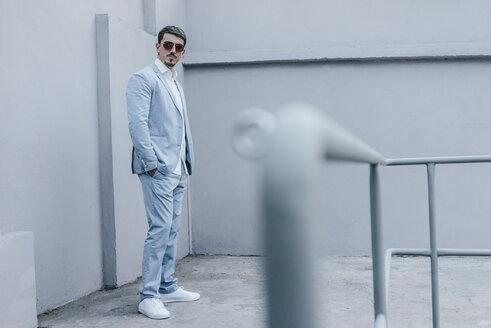 Portrait of confident businessman wearing sunglasses - KNSF00823