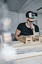 Man with architectural model and VR glasses - KNSF00832
