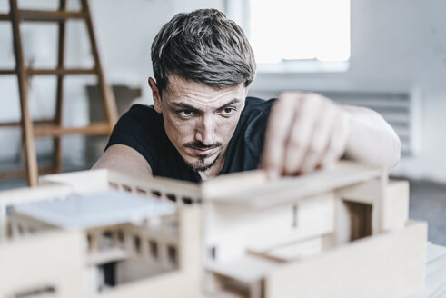 Architect working on architectural model - KNSF00862