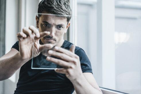 Man using transparent mobile device - KNSF00868