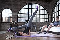 Woman doing gymnastics in studio - ZEF12062