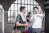Two men talking in exercise room - ZEF12077