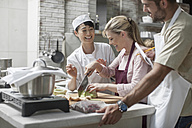 Group of people taking cooking course - ZEF12095