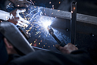 Close-up of two welders at work - ZEF12123