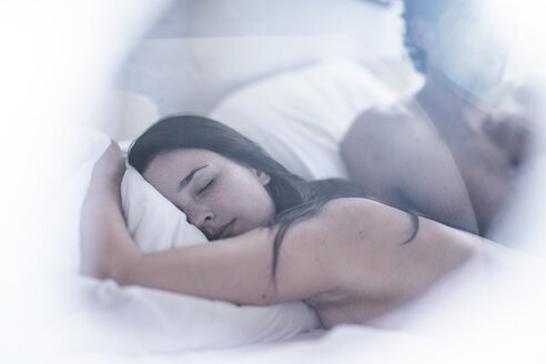 Portrait of sleeping woman with man in the background - ZEF12209