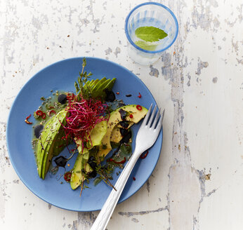 Plate of Iceberg Salad with avocado, thyme, sesame and sprouts - KSWF01772