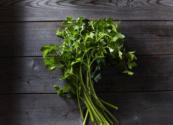 Flat leaf parsley on dark wood - KSWF01778