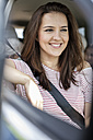 Woman sitting in car with seat belt fastend - WESTF22354