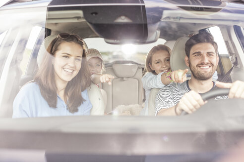 Happy family doing a road trip - WESTF22369