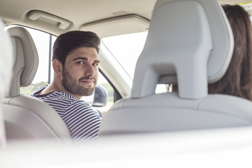 Mid adult man driving in car - WESTF22405