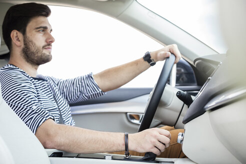 Mid adult man driving in car - WESTF22411