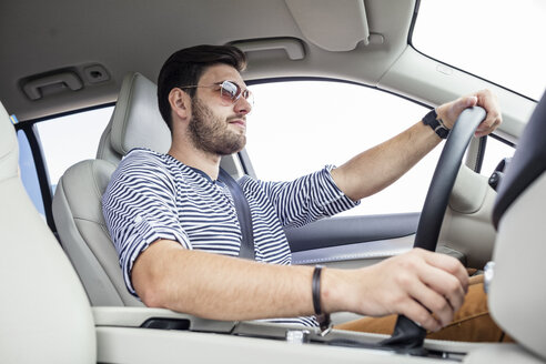 Mid adult man driving in car - WESTF22414