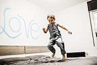 Little boy jumping on the bed - JRFF01129