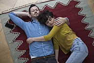 Couple relaxing together on the carpet at home - RBF05437