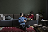 Couple relaxing together in the living room - RBF05461
