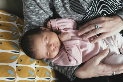 Mother holding sleeping baby girl - GEMF01356