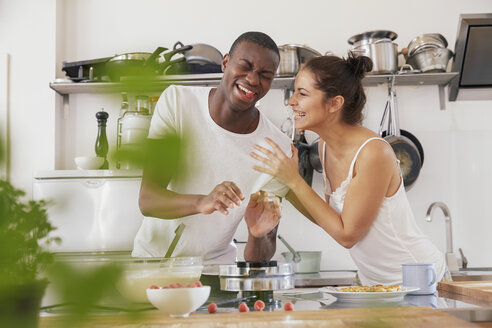 Young couple having fun together in the kitchen - FMKF03407