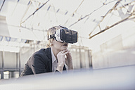 Businesswoman using Virtual Reality Glasses - FMKF03434
