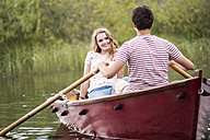 Young couple in rowing boat on the lake - HAPF01285