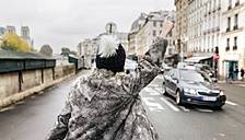 France, Paris, back view of young woman hailing a taxi - MGOF02747
