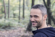 Portrait of smiling man in the woods - DWIF00816