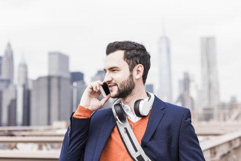 USA, New York City, man talking on cell phone - UUF09659