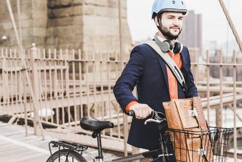 USA, New York City, man with bicycle on Brooklyn Bridge - UUF09662