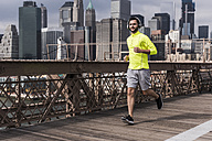 USA, New York City, man running on Brooklyn Brige - UUF09674