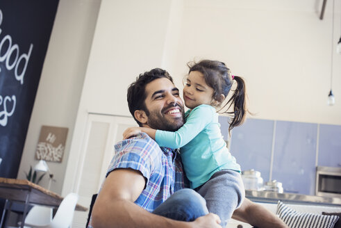 Father and daughter having fun at home - WESTF22422