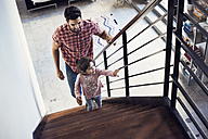 Father and daughter climbing stairs - WESTF22446