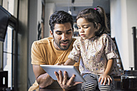 Father and daughter using digital tablet - WESTF22473