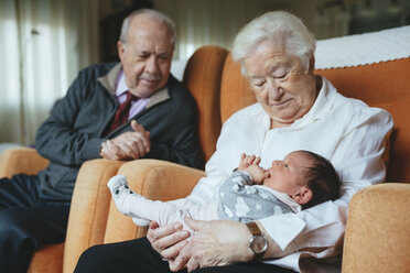 Great grandparents taking care of great granddaughter at home - GEMF01358