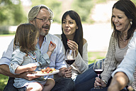 Extended family having a picnic with snacks and wine - ZEF12359