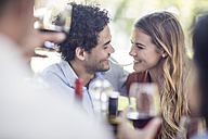 Couple sharing spaghetti at outdoor table - ZEF12377