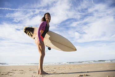 Happy woman with surfboard on the beach - ABZF01734